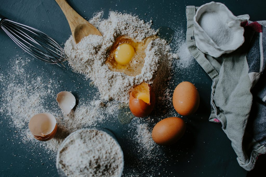 an image with wheat flour and eggs